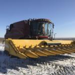 Первая в мире уборка урожая беспилотным комбайном на снегу прошла в Оренбургской области